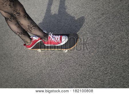 Image of a young skater girl skateboarding