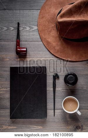 author office with hat and cup in professional writer concept on wooden work desk background top view