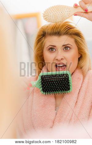 Shocked Woman Wearing Dressing Gown Brushing Her Hair