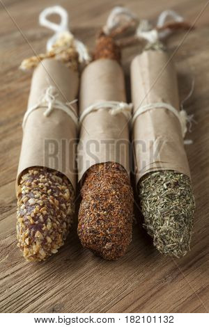 Spanish fuet sausages in three different flavors packed in paper