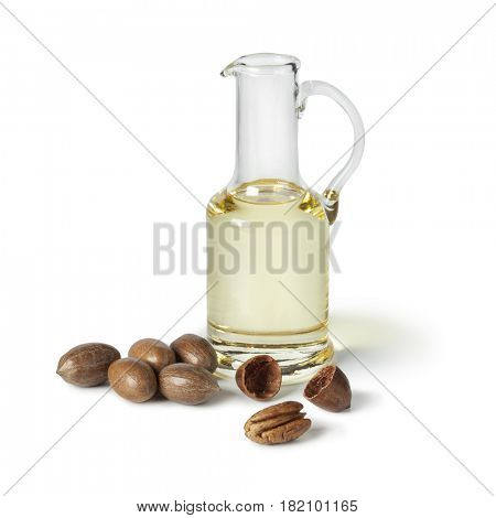 Glass can with pecan oil on white background