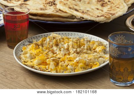Traditional Moroccan  breakfast with scrambled eggs, pancakes and mint tea