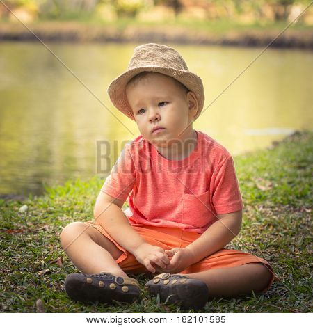 Boy at lakeside at botanical garden. Mauritius