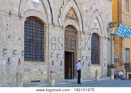 Policeman on guard in front of the Town Hall Palazzo Pubblico - 30 September 2011, Siena, Italy