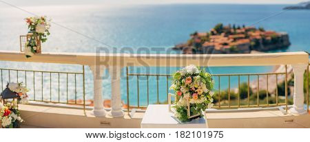 Wedding ceremony on the background of the island of Sveti Stefan in Montenegro.