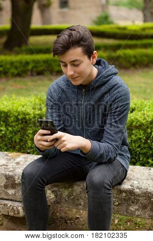 Cool teenager with fifty years old and a mobile on the street