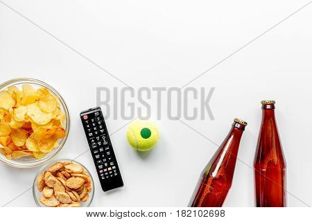 watching sport football match set with chips on white desk background top view mockup
