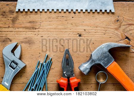 builder work with professional repairing implements set for decorating and painting on wooden background top view mock up