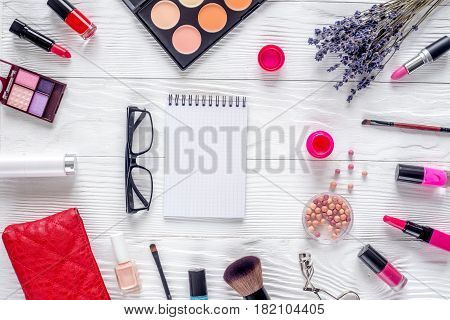 cosmetics composition with notebook and lavender flowers on white woman desk background top view mockup