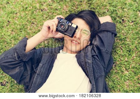 Young asian boy holiday leisure taking photo