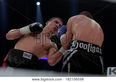 ODESSA, UKRAINE - JULY 21, 2012: Vyacheslav Uzelkov (right) vs Mohamed Belkacem in fight for WBO Inter-Continental light heavyweight title. The fight was organized by K2 Promotions of brothers Klichko