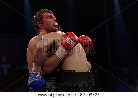 ODESSA, UKRAINE - JULY 21, 2012: Fight Valeriy Brazhnyk (left) vs Igor Fanian. The tournament was organized by the company K2 Promotions of brothers Klichko