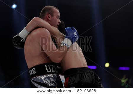 ODESSA, UKRAINE - JULY 21, 2012: Vyacheslav Uzelkov (left) vs Mohamed Belkacem in fight for WBO Inter-Continental light heavyweight title. The fight was organized by K2 Promotions of brothers Klichko