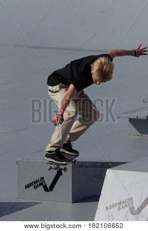 MOSCOW, RUSSIA - JULY 8, 2012: Unidentified athlete in skateboarding competition during Adrenalin Games in Moscow. Adrenalin Games is the major international event in the field of extreme sports