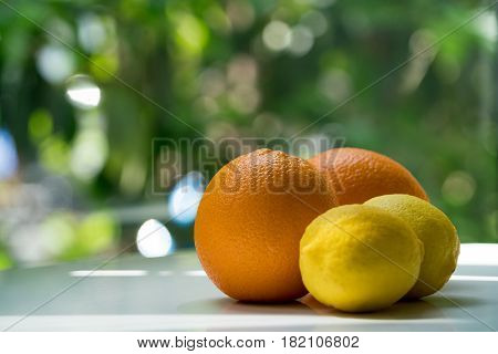 The organic orange and lemon isolated on green blurred background