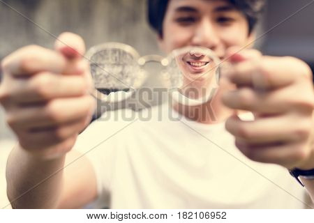 Asian Guy Holding Glasses Lens