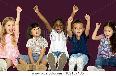 Diverse Group Of Happy Kids Holding Hands Up