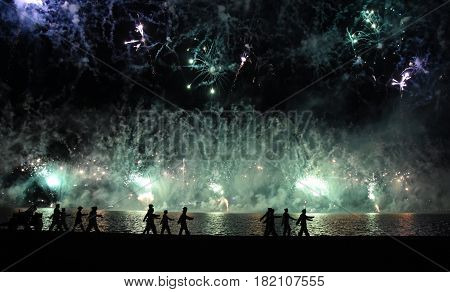 Skyfire 2017 in Canberra Australia. Fireworks during Canberra's annual SkyFire appear above Lake Burley Griffin. Australian Federation Guard moving away at Gallipoli Reach.