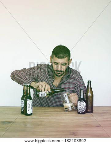 Middle eastern drinking beer on the wooden table