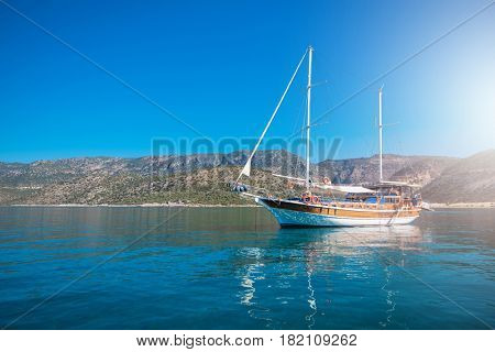 yacht on bay and castle in Kekova, near ruins of the ancient city on the Kekova island, Turkey