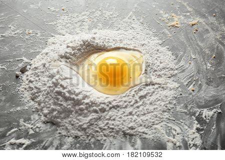 Preparing dough for ravioli on table