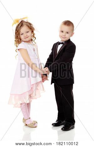 Cute little boy and girl holding hands.Isolated on white background.