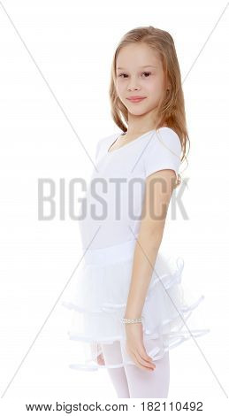 Portrait of a beautiful little girl gymnast in a white dress.Isolated on white background.