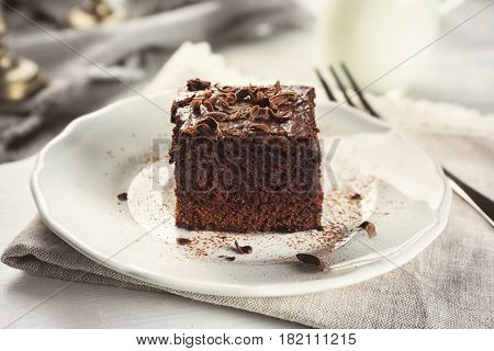Plate with delicious cocoa brownie on table