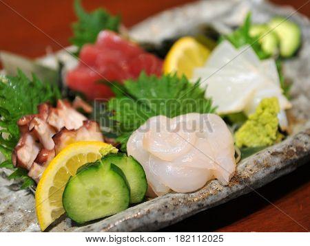Fresh Sashimi Of Fugu Fish With Cucumber, Lemon And Wasabi