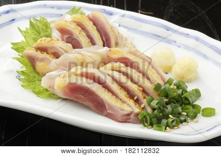 Roasted Skin Fresh Sliced Chicken With Onion And Herbs On White Platter