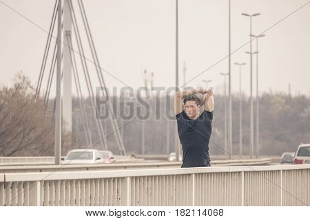 One Young Man, Stretching Arm On Bridge Cars Fence