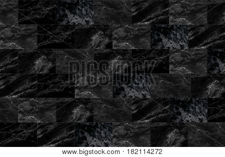 The luxury of black marble tiles texture and background, Can be used for creating abstract marble surface effect to your design art work.