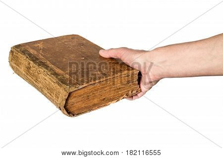 Hand holding an old book isolated on white background