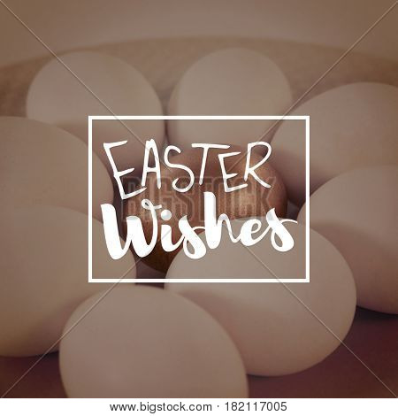 Easter greeting against white and golden easter eggs in plate