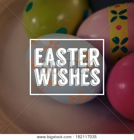 Easter greeting against painted easter eggs on plate