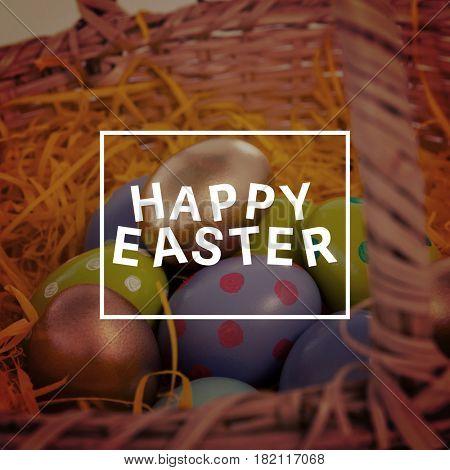 Easter greeting against various easter eggs in wicker basket