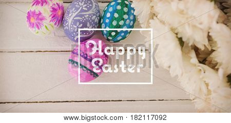happy easter against multicolored easter eggs and white flowers