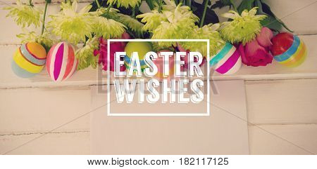 Easter greeting against painted easter eggs with flowers and envelope