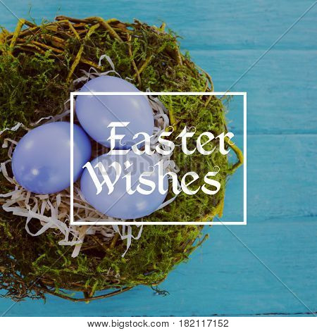 Easter greeting against violet easter eggs against blue wood background