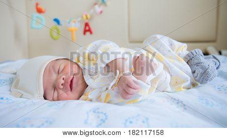 Portrait newborn asian baby asleep, close up