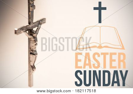 easter sunday logo against close up of silver crucifix