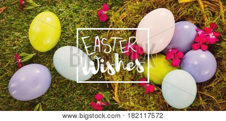 Easter greeting against multicolored easter eggs in nest