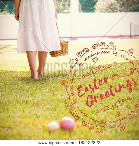 Little girl collecting easter eggs against happy easter red logo against a white background