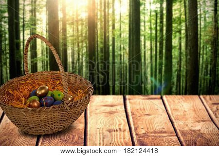 Easter eggs in paper nest basket against view of tropical forest