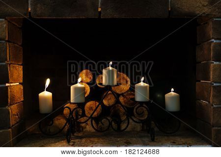 Five whie burning candles in candlestick used for decoration background