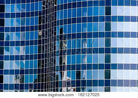 Glass Wall Of Modern Office Building With Sky Reflections