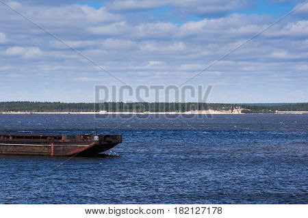 Unloaded Barge On A Blue River. Forest On The Horizon. River Port Equipment