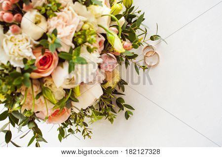 Photo Image Of A Classic Wedding Gold Rings Of The Bride And Groom On A White Table, With A Beautifu