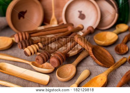 various handmade wooden kitchen utensils on vintage background