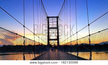 200 year Rattanakosin Sompoch bridge during twilight sky. Tak province Thailand